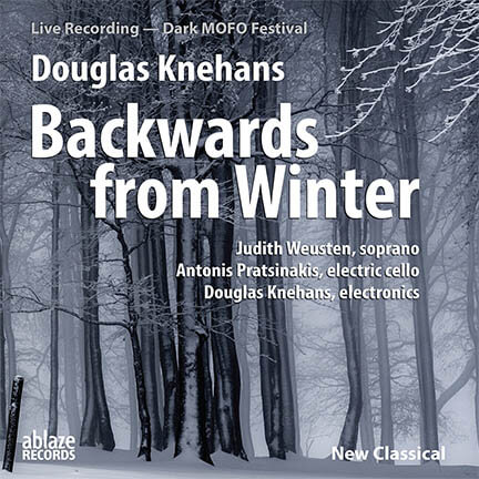 "The CD cover from the opera ""Backwards from Winter"" with libretto by Juanita Rockwell depicting a background photo image of tall thin trees in the snow. The atmosphere is misty. The lettering is in white, with title of the opera in large bold letters."