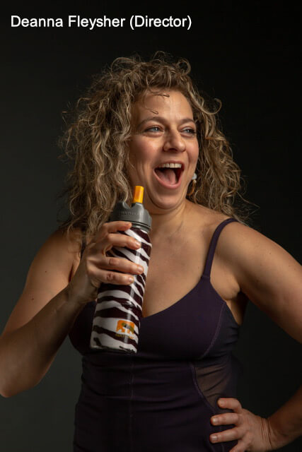 Director, Deanna Fleysher, grips zebra-striped water bottle with comic grin on her face