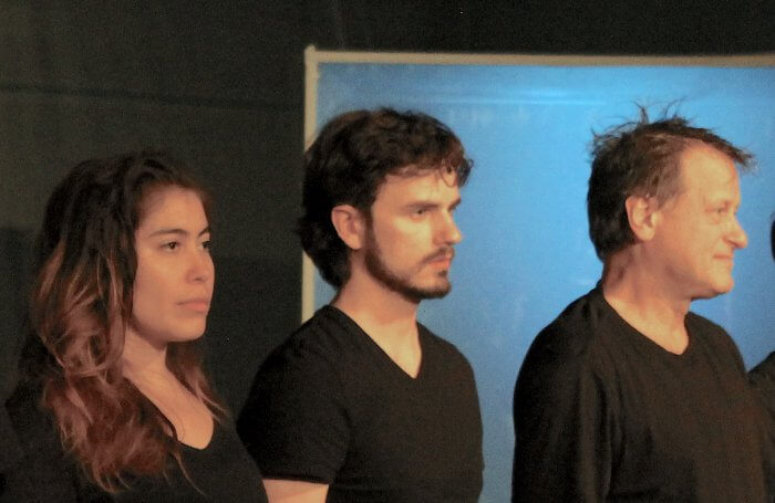 Cast members, young Latina, young white make and older white male. all in black shirts